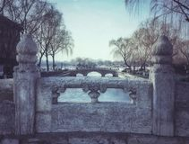 Ancient bridge of white marble in front of houhai temple of fire. Houhai scenic spot royalty free stock photo