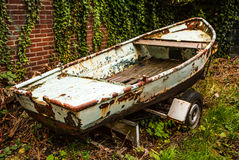 Ancient broken boat on land Stock Photography