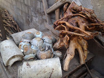 Ancient broken porcelain. With Tree root in ancient village Stock Photos