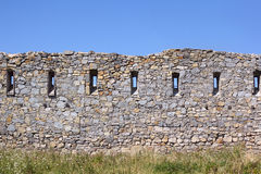 Ancient broken wall with little windows Royalty Free Stock Image
