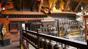 Ancient bronze and brass decorated temple, Rudra Varna Mahavihar, unique buddhist shrine with plenty of prayer wheels in. Lalitpur Patan. World heritage site stock video footage
