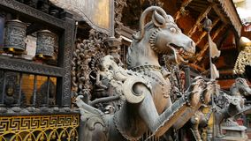 Ancient bronze and brass mythological sculptures and artifacts, Rudra Varna Mahavihar, unique golden buddhist temple in. Lalitpur Patan. World heritage site stock video footage