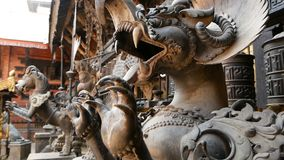 Ancient bronze and brass mythological sculptures and artifacts, Rudra Varna Mahavihar, unique golden buddhist temple in. Lalitpur Patan. World heritage site stock video