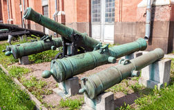 Ancient bronze cannons in Artillery museum in summer sunny day Royalty Free Stock Image