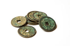 Ancient bronze coins of China on white Royalty Free Stock Photos