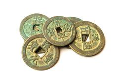 Ancient bronze coins of China on white Royalty Free Stock Photo