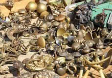Ancient bronze handles for sale at flea market Royalty Free Stock Image