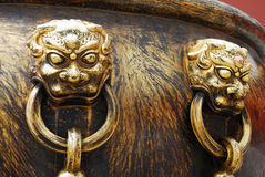 Ancient bronze lions as a handle of vat Royalty Free Stock Images