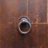 Ancient bronze round knocker on old brown door. Travel to Italy - ancient bronze round knocker on old brown door in Florence city royalty free stock photography