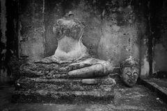 Ancient Buddha head cut near the body in Sukhothai Royalty Free Stock Photos