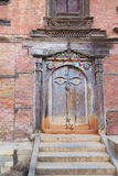 Ancient Buddha's All Seeing Eye Door, Kathmandu,. Image of an ancient door with the all seeing eyes of Buddha at the Hanuman Royal Palace grounds within UNESCO's stock photography
