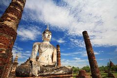 Ancient Buddha statue against blue sky at wat Mahathat Royalty Free Stock Photography