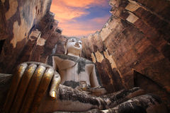 Ancient buddha statue against twilight sky in Sukhothai Stock Photography