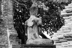 Ancient buddha statue in archaeological site at Wat Mahathat temple . old sculpture in history is a world heritage . black and. White color stock images