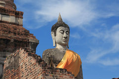 Ancient buddha statue with blue sky Stock Photography