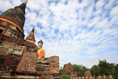 Ancient Buddha statue and brick pagodas Royalty Free Stock Photos