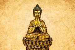 Ancient buddha statue in front of an eroded background Royalty Free Stock Photo
