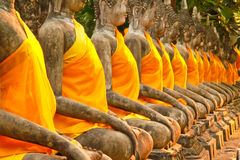 The ancient Buddha statue in front of the pagangel Stock Photography