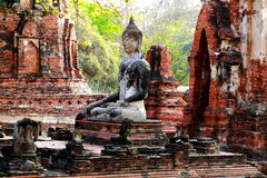 Ancient buddha statue at Mahathat temple, historic site in Thailand. Royalty Free Stock Photos