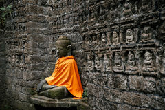 Ancient Buddha statue in orange cover Royalty Free Stock Photo