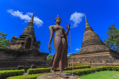 Ancient Buddha statue and pagoda Stock Images