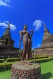 Ancient Buddha statue and pagoda Stock Photos