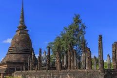Ancient Buddha statue and pagoda Stock Photography