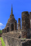 Ancient Buddha statue and pagoda Stock Photo