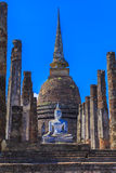 Ancient Buddha statue and pagoda Stock Image