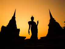 Ancient Buddha Statue and Pagodas at Sunset, Sukhothai, Thailand Stock Photos