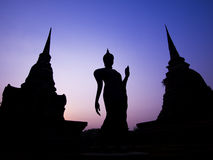 Ancient Buddha Statue and Pagodas at Twilight, Sukhothai Province, Thailand Stock Photo