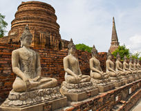 Ancient buddha statue in a row. Ancient buddha statue in Ayutthaya province of Thailand Stock Image