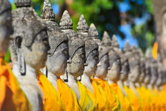 Ancient buddha statue in a row. Ancient buddha statue at Wat Yai Chai Mongkhol in Ayutthaya province of Thailand Royalty Free Stock Photos
