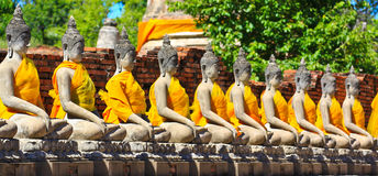 Ancient buddha statue in a row Stock Photography