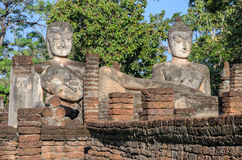 Ancient buddha statue and ruins temple in Thailand Stock Photos
