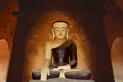 Ancient Buddha statue sitting in meditation. Bagan, Myanmar. Royalty Free Stock Images