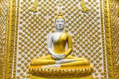 Ancient buddha statue sitting on wall of pagoda Stock Photo