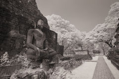 Ancient Buddha statue at Sukhothai Historical Park. Stock Photo