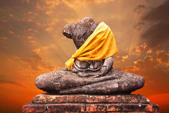 Ancient buddha statue and sunset Stock Images