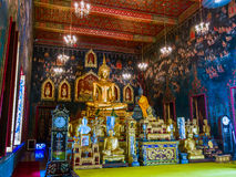 Ancient Buddha statue in Thailand with mural painting around. Royalty Free Stock Images