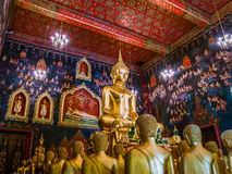 Ancient Buddha statue in Thailand with mural painting around. Royalty Free Stock Image