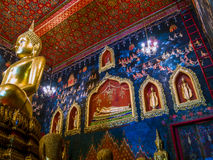 Ancient Buddha statue in Thailand with mural painting around. Thai ancient arts Royalty Free Stock Images