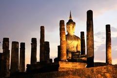 Ancient buddha statue at twilight Stock Image