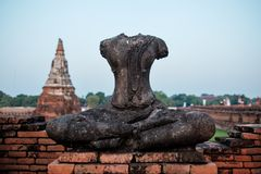 Ancient buddha statue were destroyed during the war,no head in Ayutthaya province, Thailand. Ancient buddha statue were destroyed during the war,no head in Wat Royalty Free Stock Photography