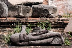 Ancient buddha statue were destroyed during the war,no head in Ayutthaya province, Thailand. Ancient buddha statue were destroyed during the war,no head in Wat Stock Photography