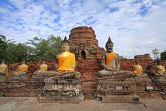 Ancient Buddha statues against blue sky Royalty Free Stock Photography
