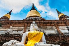 Ancient Buddha statues against blue sky at Ayutthaya, Thailand Royalty Free Stock Photography