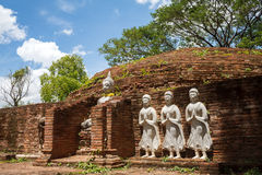 Ancient Buddha statues against blue sky. In thailand Royalty Free Stock Photography