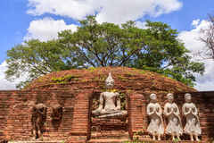 Ancient Buddha statues against blue sky. In thailand Stock Image