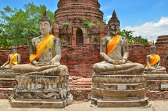 Ancient buddha statues with blue sky Stock Images